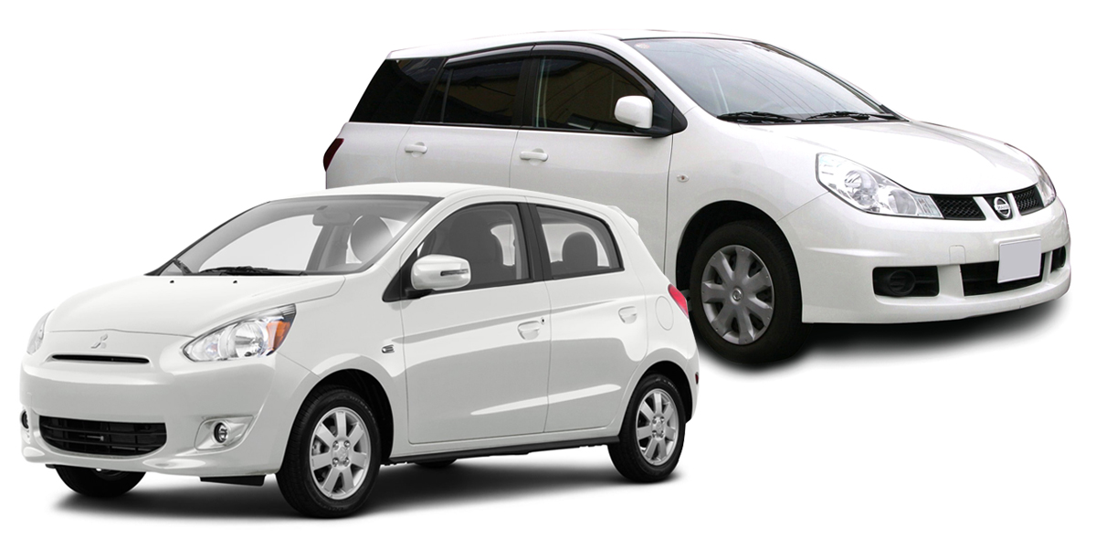 Vehicle Rentals - Image of two white cars available for rent
